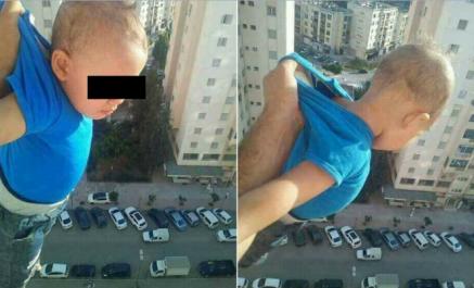 La photo d'un enfant suspendu du haut d'un immeuble suscite la polémique